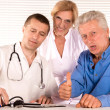 Doctor and citizens — Stock Photo