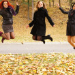 Three girls jumping — Stock Photo
