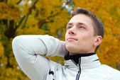 Guy in autumn park — Stock Photo