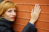 Woman at wall — Stock Photo