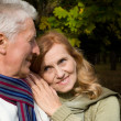 Elderly couple in park — Foto Stock