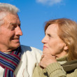 Aged couple at sky — Stock Photo