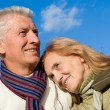 Aged couple at sky — Stock Photo #7621130