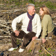 Old couple sitting at ground — Stock Photo #7621152