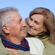 Happy old couple at sky — Stock Photo #7621163