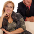 Old couple at sofa — Stock Photo
