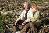 Old couple at roots — Stock Photo