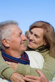 Happy old couple at sky — Stock Photo