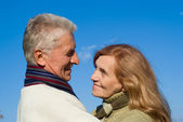 Happy aged couple at sky — Stock Photo