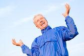 Elderly man at sky — Stock Photo