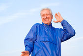 Happy old guy at sky — Stock Photo