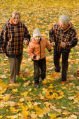 Grandparents with child at nature — Stock Photo