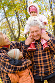 Grandparents with children at nature — Stock Photo