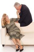 Old man and woman at sofa — Stock Photo