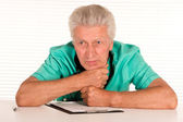 Old doctor at table — Stock Photo