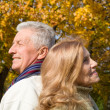 Aged couple at autumn forest — Stock Photo