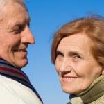 Happy aged couple at sky — Stock Photo #7666620