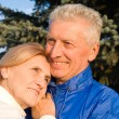 Elderly couple at nature - Stock Photo