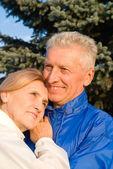 Elderly couple at nature — Stock Photo