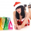 Stock Photo: Pretty snow maiden with gifts