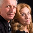 Aged couple on black — Stock Photo