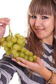 Girl and grapes — Stock Photo