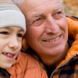 Old man with grandson - Stock Photo