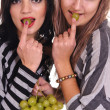 Girls with grapes — Stock Photo