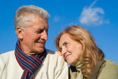 Elderly couple at sky — Stock Photo