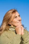 Elderly woman and sky — Stock Photo