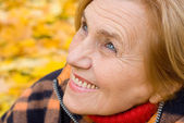 Cute aged woman at nature — Stock Photo