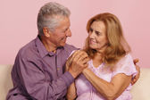 Old couple on pink — Stock Photo