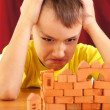 Angry little guy constructing — Stock Photo #7890517