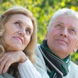 Old couple at nature - Stock Photo