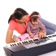 Mom and child with piano — Stock Photo