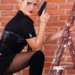 Blonde with gun — Foto Stock