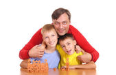 Dad with sons at table — Stock Photo
