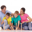 Family playing on floor — Stock Photo