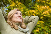 Old woman at forest — Stock Photo