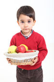 Child bring basket fruit — Stock Photo