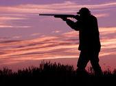 Hunter Shooting Shotgun at Sunset — Stock Photo