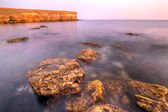 Red stones on sea coast — Stock Photo