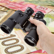 Binoculars and dollar — Stock Photo