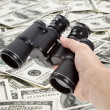 Binoculars and dollar — Stock Photo #7369869