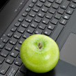 Green apple and laptop — Stock Photo