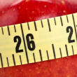 Red apple and Tape Measure — Stockfoto #7396710