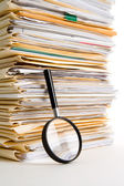 File Stack and Magnifying Glass — Stock Photo