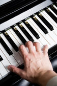 Playing a piano — Stock Photo