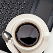 Coffee cup and computer — Stock Photo