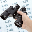 Binoculars and Financial Chart — Stock Photo #7495530